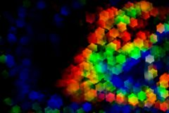 Bokeh, abstract colorful background of defocused hexagon stars. Layer to overlay.  stock image