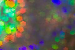 Bokeh, abstract colorful background of defocused hexagon stars. A lot of colorful flare into the mist. Bokeh, abstract colorful background of defocused hexagon royalty free stock photography
