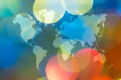 Bokeh abstracto de la luz con el mapa del mundo Foto de archivo libre de regalías