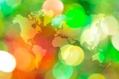Bokeh abstracto de la luz con el mapa del mundo Imagen de archivo libre de regalías