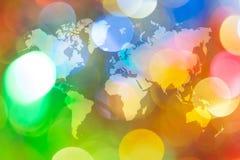 Bokeh abstracto de la luz con el mapa del mundo Fotos de archivo libres de regalías