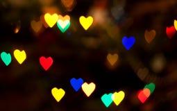 Bokeh abstracto del corazón de las luces de la Navidad Foto de archivo
