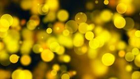 Bokeh abstracto del oro con el fondo negro Fotografía de archivo