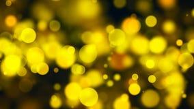 Bokeh abstracto del oro con el fondo negro Foto de archivo libre de regalías