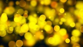 Bokeh abstracto del oro con el fondo negro Imágenes de archivo libres de regalías