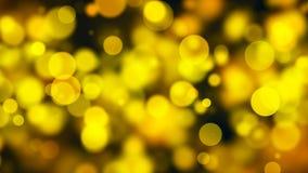 Bokeh abstracto del oro con el fondo negro Imagenes de archivo