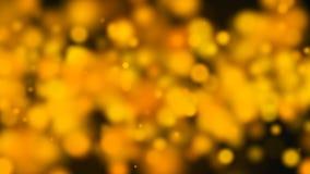 Bokeh abstracto del oro con el fondo negro Foto de archivo