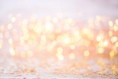 Bokeh abstracto del oro Fondo del tema de la Navidad y del Año Nuevo Fotografía de archivo libre de regalías