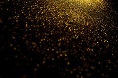 Bokeh abstrait d'or Fond noir photographie stock libre de droits