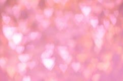 Bokeh abstrait de forme de coeur de rose de fond Photographie stock