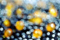 Bokeh abstrakt zaświeca pomarańcze czerń Zdjęcia Royalty Free