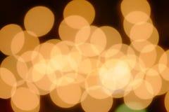 Bokeh anaranjado en los 01 oscuros Imagen de archivo libre de regalías
