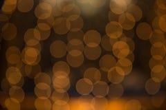 Bokeh arancio, fondo del bokeh, luce del bokeh Fotografia Stock