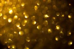 Bokeh astratto dell'oro Fotografie Stock
