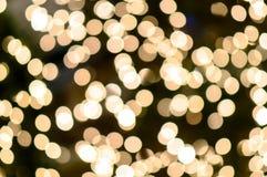 Bokeh auf defocused Licht des Goldgelbs Lizenzfreie Stockbilder