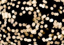 Bokeh auf defocused Licht des Goldgelbs Stockbilder