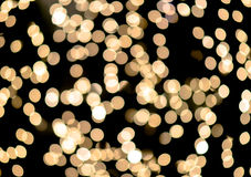 Bokeh auf defocused Licht des Goldgelbs Stockbild