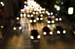 Bokeh av aftontrafikstockning på vägen i stad Fotografering för Bildbyråer