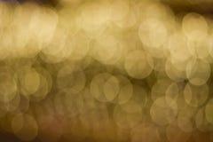 Bokeh av den guld- ljusa kulan Arkivfoton