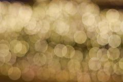 Bokeh av den guld- ljusa kulan Royaltyfri Bild