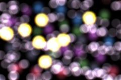 Bokeh avec les lumières violettes, fond abstrait Images stock
