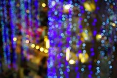 Bokeh azul e alaranjado da fileira clara circular fotos de stock
