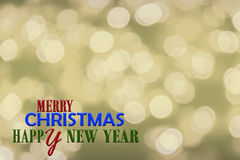 Bokeh background in Christmas eve and text of Merry Christmas an Royalty Free Stock Images