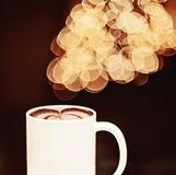 Bokeh background and coffee. A cup of coffee latte and bokeh lights in the background Stock Image