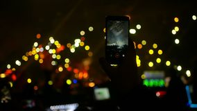 Phone crowd lights concert. Bokeh background of crowd with lights at the concert stock video footage