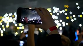 Phone crowd lights concert. Bokeh background of crowd with lights at the concert stock video
