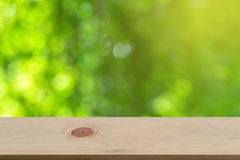 Bokeh background with empty wooden. Royalty Free Stock Photos