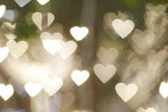 Bokeh background. Gold heart shape bokeh background Stock Photography