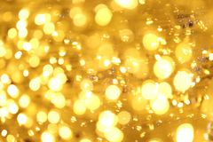 Bokeh background gold yellow colorful of merry christmas, Happy new year bokeh lighting shine on night background, Bokeh glitter. The Bokeh background gold stock photo