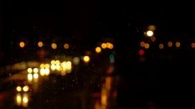 Bokeh background of trafic lights at night. Bokeh background of green and orange trafic lights at night royalty free stock image