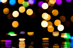 Bokeh background with many light particles. Bokeh background with many colorful light particles and reflections Stock Images