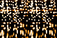 Bokeh background with many light particles. And reflections Royalty Free Stock Photo