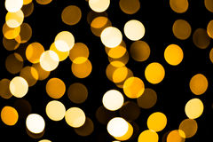 Bokeh background with many light particles. In yellow Stock Image