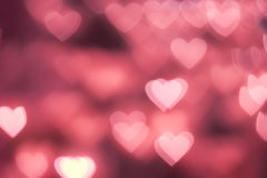 Bokeh background. Pink Heart shape bokeh background royalty free stock photo