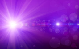 Bokeh background with purple glitter sparkles rays lights bokeh on purple background. Stock Photography