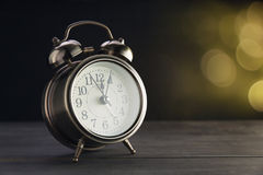 Bokeh background with retro alarm clock Royalty Free Stock Image