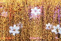 Bokeh background and snow shape gold yellow colorful merry christmas, Happy new year bokeh lighting shine on night background. The Bokeh background and snow Stock Photo