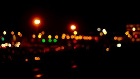 Bokeh background of trafic lights at night. Bokeh background of green and orange trafic lights at night royalty free stock images