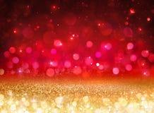 Bokeh bakgrund - blänka effekt med guld- och rött royaltyfri fotografi
