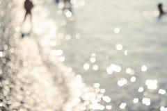 Bokeh bakgrund, hav, strand, sol Royaltyfri Bild