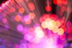 Bokeh bakgrund med purpurfärgad rosa för kulöra ljus och rött arkivbild
