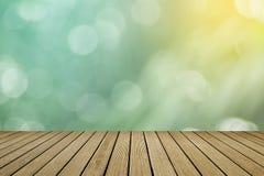 Bokeh bakgrund med tomt trä Fotografering för Bildbyråer