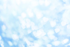 Bokeh bianco su fondo blu Immagine Stock