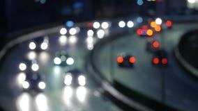 Bokeh billjus på natten Ut ur fokustrafikljus arkivfilmer