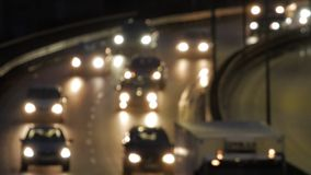 Bokeh billjus på natten Ut ur fokustrafikljus lager videofilmer