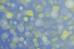 Bokeh blanco amarillo azul Textura del fondo de la Navidad fotografía de archivo
